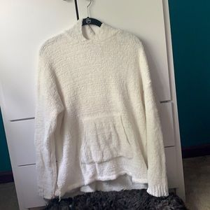white fuzzy sweater with a hood